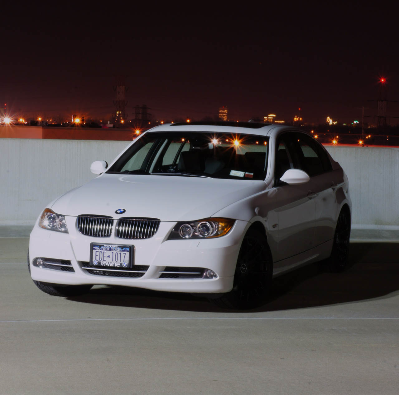 white 2008 BMW 335xi sedan
