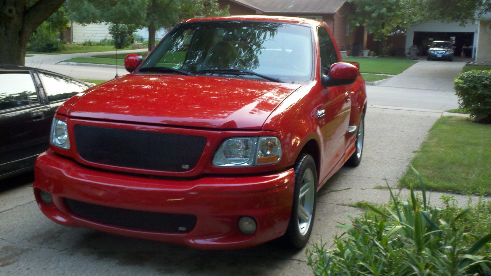 Red 2003 Ford F150 Lightning