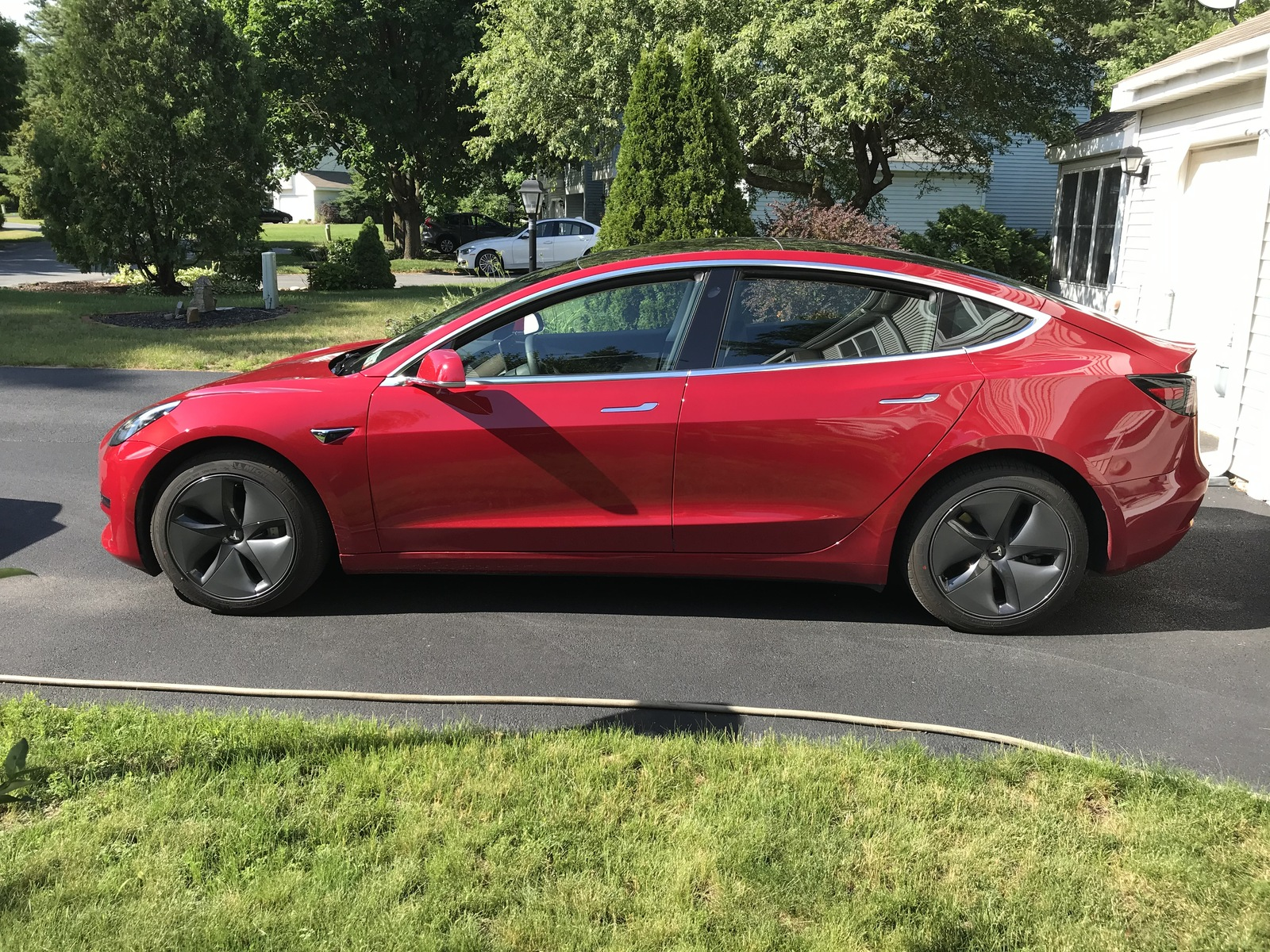 red 2020 Tesla Model 3 Performance (stealth)